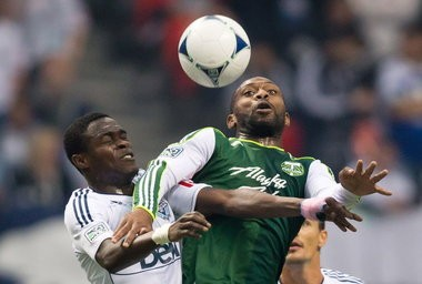 Timbers midfielder Franck Songo'o (right) will not return to the team for the 2013 season, Portland coach Caleb Porter confirmed Wednesday night.