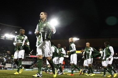 Portland midfielder and captain Will Johnson, (foreground, No. 4) will try to lead the Timbers to their first win of the MLS regular season when they play at Seattle Saturday.