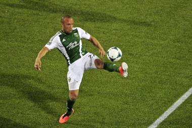 Portland center back Mikael Silvestre suffered a season-ending torn ACL in his knee on this play against the New England Revolution at Jeld-Wen Field May 2.