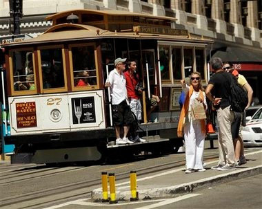 In this Sept. 1, 2010, photo, visitors wait to board a cable car in San Francisco's Union Square. In this city of innumerable tourist attractions, the clanging cable cars stand out as a top draw. They also stand out for the inordinate number of accidents and the millions of dollars annually the city pays out to settle lawsuits for broken bones, severed feet and bad bruises caused when 19th Century technology runs headlong into 21st Century city traffic and congestion. Recently, five passengers and two workers were injured after an inch-long bolt in the track caused their cable car to slam to a sudden stop.