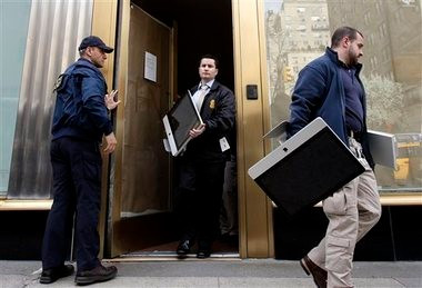 Federal agents remove items, including computers, from an art gallery in New York on Tuesday. The agents were raiding the gallery as part of investigation into what Federal authorities in New York say was high-stakes poker games attended by professional athletes, Hollywood celebrities and Wall Street titans, run by members of Russian organized crime.