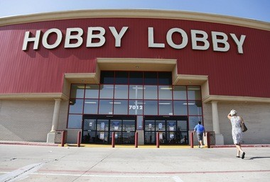 Customers walk to a Hobby Lobby store in Oklahoma City, Monday, June 30, 2014. The Supreme Court ruled Monday that employers can hold religious objections that allow them to opt out of the new health law requirement that they cover contraceptives for women. The Hobby Lobby chain of arts-and-crafts stores is by far the largest employer of any company that has gone to court to fight the birth control provision.