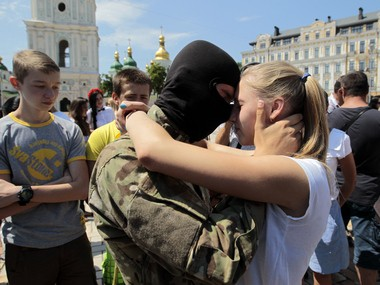 A girl says goodbye to her friend before they were sent to the eastern part of Ukraine to join the ranks of special battalion Azov on July 16, 2014.