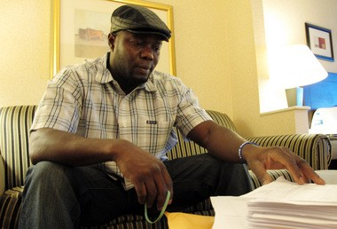 Josephus Weeks, nephew of Ebola patient Thomas Eric Duncan who died on Oct. 8, 2014, in Dallas, Texas, looks at hundreds of pages of medical documents in a hotel room in Kannapolis, N.C., on Oct. 10.