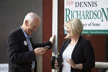 Oregon Republican Secretary of State candidate Dennis Richardson, left, and his wife Cathy Richardson, right, smile during an election night gathering for supporters in Portland, Ore., Tuesday, May 17, 2015.