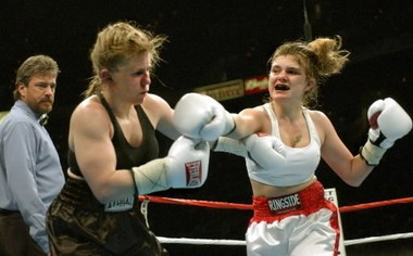 Samantha Browning delivers a punch to Tonya Harding in 2003.