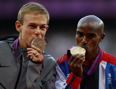 Galen Rujpp (left) with training partner Mo Farah at the medal ceremony for the 10,000 in London.