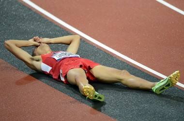 Matthew Centrowitz sprawls out on the track after finishing fourth in the 1,500 at the 2012 Olympic Games.