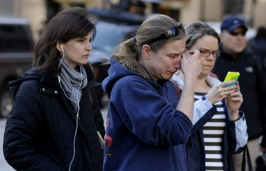 Mourners at a makeshift memorial for victims of the bombings at the Boston Marathon.