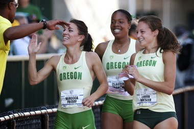 Laura Roesler (right) takes a victory lap at last year's Pac-12 Championships along with Becca Friday (left) and Claudia Francis after the Ducks swept the top three spots in the 800 meters.