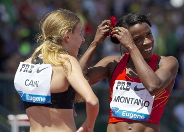 Olympian Alysia Montano prepares to give her trademark flower to prep sensation Mary Cain after the conclusion of the 800 at the Prefontaine Classic.