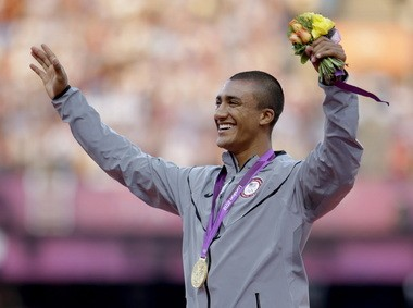 Bend's Ashton Eaton waves from the podium after being presented with a gold medal in the men's decathlon during the athletics in the Olympic Stadium at the 2012 Summer Olympics, London, Friday, Aug. 10, 2012.
