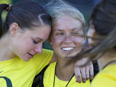 Oregon Jordan Hasay (center) gives teammate Anne Kesselring a hug after the meet.