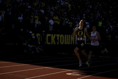 Oregon's Elijah Greer bursts out of the shadow and across the finish line in the final of the NCAA 800 meters.