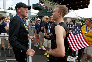 Nike Oregon Project's Galen Rupp (right) speaks to coach Alberto Salazar after finishing third in the 5,000 meters at the U.S. Track & Field championships in Eugene on Sunday.