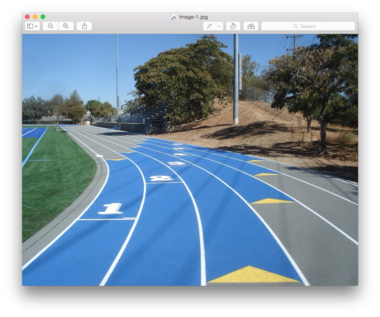 An outdoor track on which Beynon Sports Services has put in colored exchange zones.