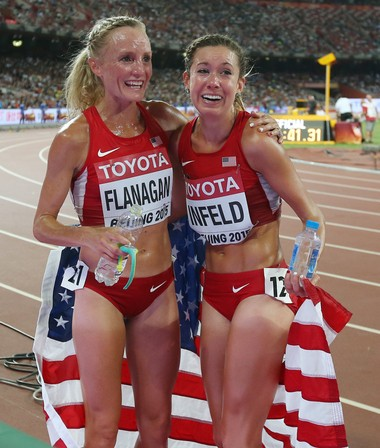 United States' Emily Infeld (right) is embraced by teammate Shalane Flanagan after winning the bronze medal in the women's 10,000 at last year's World Outdoor Championships.