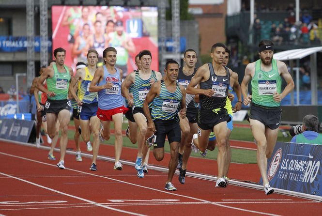 As Ben Blankenship leads, Andrew Wheating (back) trails the 13-man field in the July 10 1,500 meter final at the U.S. Olympic track and field trials at Hayward Field.