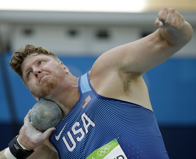 United States' Ryan Crouser makes an attempt in the men's shot put qualification during the athletics competitions of the 2016 Summer Olympics at the Olympic stadium in Rio de Janeiro, Brazil, Thursday, Aug. 18, 2016.