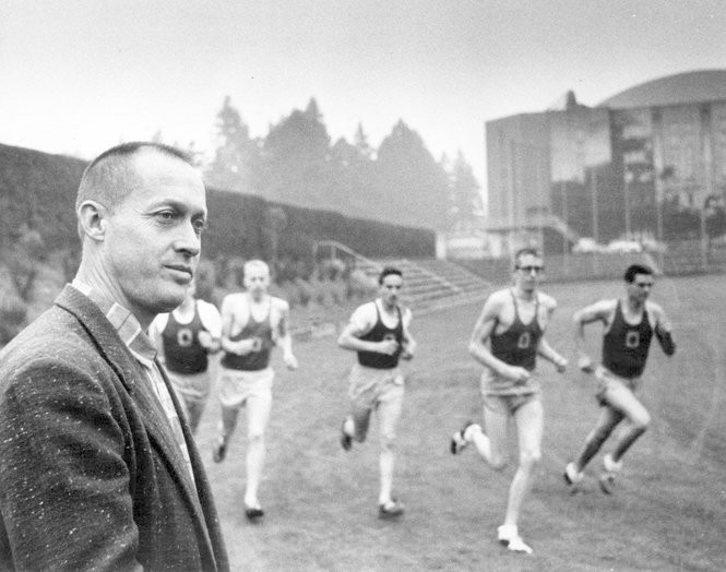 Former University of Oregon track coach and Nike co-founder Bill Bowerman leads a workout of UO athletes, including Phil Knight (second runner from left), in about 1959.