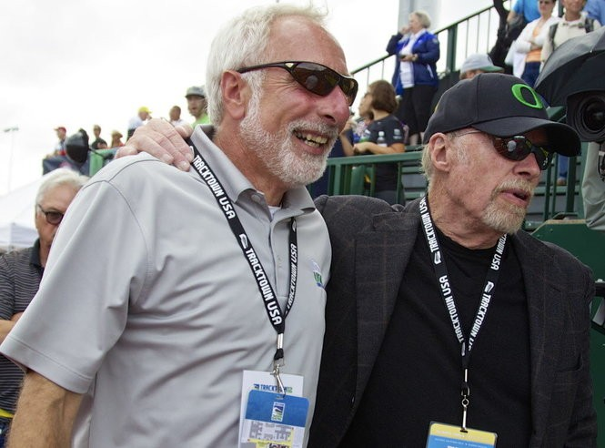 UO associate athletic director and Track Town USA President Vin Lananna and Nike co-founder Phil Knight head off the track after the closing ceremonies after the 2012 U.S. Olympic trials at Hayward Field.