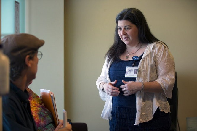 OHSU's Transgender Health Program coordinator Amy Penkin (right) accompanies Benny Monroe of Springfield to a follow-up appointment at OHSU following Monroe's double mastectomy. Kristyna Wentz-Graff/Staff