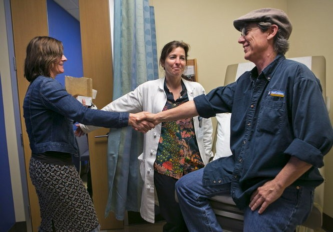 Dr. Christina Milano (left) and Dr. Juliana Hansen talk with patient Benny Monroe at a post-surgical appointment at OHSU. Dr. Hansen performed Monroe's double mastectomy, one of nearly 40 top surgeries Dr. Hansen has performed this year thus far. Dr. Milano is Monroe's physician and stopped by to celebrate this milestone event with them. Kristyna Wentz-Graff/Staff