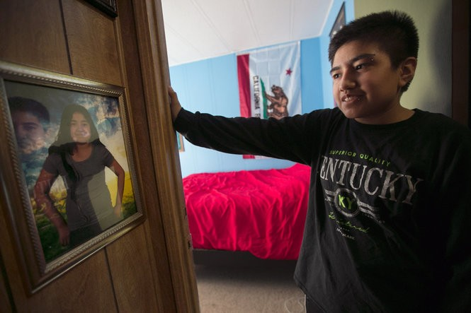 """After Jay transitioned, his mother left a few old photos hanging in the house. One of his middle school pictures hung right outside his room. The pictures reminded Jay of a painful time. """"I didn't really know how to be myself because I didn't know what part of me was not being myself."""" (Kristyna Wentz-Graff/2015)"""