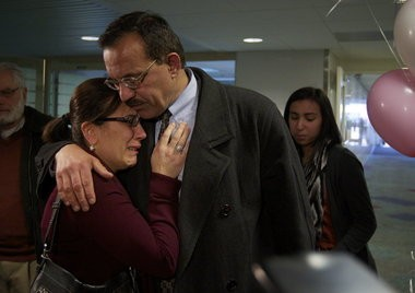 Jamal Tarhuni receives a hug from his wife, Nariman Abdusamed, after his arrival at Portland International Airport last February. He was supposed to return home four weeks earlier but was detained and questioned by an FBI agent who told him he was on the no-fly list.