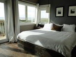 A room with a balcony boasts an expansive beach view at the Inn at Discovery Coast in Long Beach, Wash.