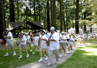 The Get a Life Marching Band marches through Mt. Tabor Park during the Portland Parks and Recreation celebration of Mount Tabor's 100th anniversary as a Portland park.
