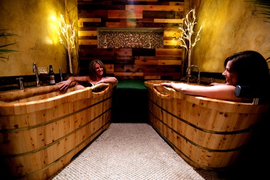 """Hop in the Spa is a new """"beer spa"""" in Sisters, Oregon, that uses hops-infused baths and oils, also pouring pints of beer and wine, of course. (Photo courtesy of Hop in the Spa)"""