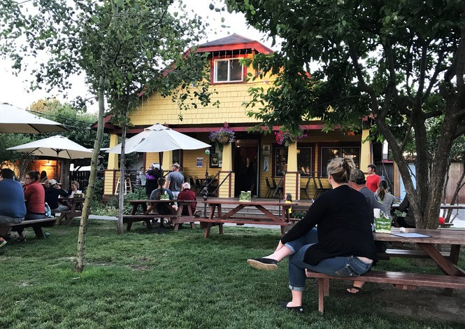 People gather on a warm summer night at Terminal Gravity Brewing, a brewery in Enterprise, just outside of Joseph. (Jamie Hale/Staff)