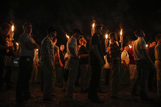 "Multiple white nationalist groups march with torches through the UVA campus in Charlottesville on Friday, August 11, 2017. When met by counter protesters, some yelling ""Black lives matter,"" tempers turned into violence. Multiple punches were thrown, pepper spray was sprayed and torches were used as weapons."