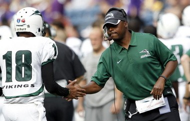 Portland State head coach Nigel Burton greets Thomas Carter after a touchdown by Portland State against Washington in the second half of their nonconference game Sept. 15, 2012, in Seattle. Washington, of the Pac-12 Conference, claimed a 52-13 victory over the Vikings of the Big Sky Conference.