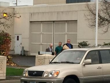 Dave Dahl with his attorney Stephen Houze (left) and another man, as Dahl left Washington County Jail free on bail.