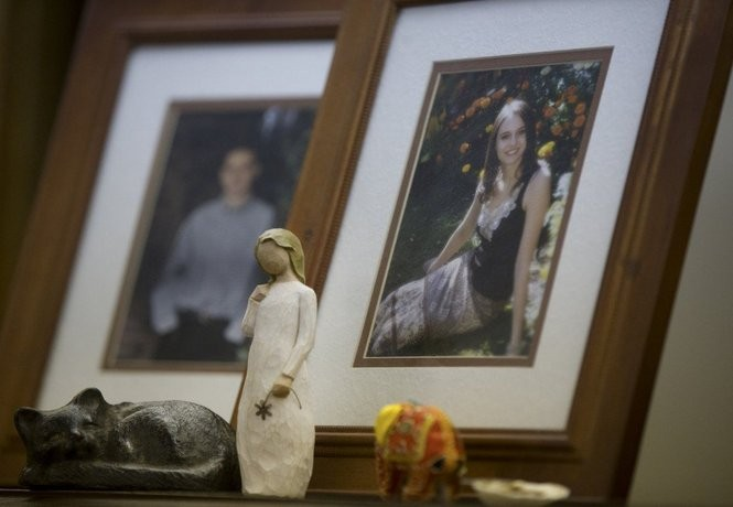 A statue and other mementos sit in front of Madaline Pitkin's photo in her parent's home in North Portland's Overlook neighborhood.