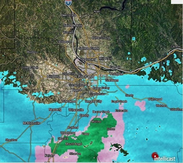 The storm approaches the metro area from the south Thursday morning. The blue area is snow, pink is ice and freezing rain, and green is rain.