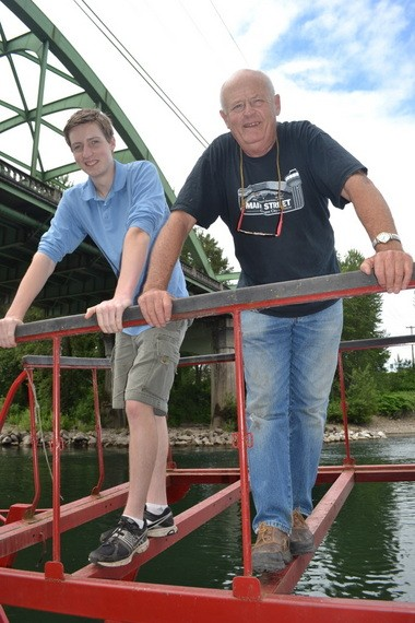 Jerry Herrmann (right) works with volunteer Matthew Riegg, 17, at the River Resource Museum in Oregon City to prepare for this summer's Discovery Cruises.