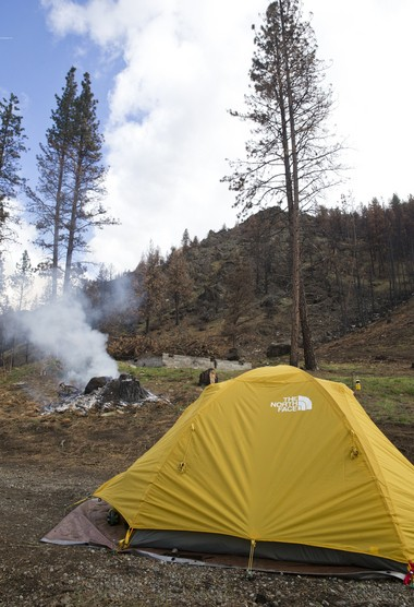 In April, Mike Mannell and his wife were staying in a tent at the site of their home, which burned in the Canyon Creek fire. The Mannells had recently returned to the area.
