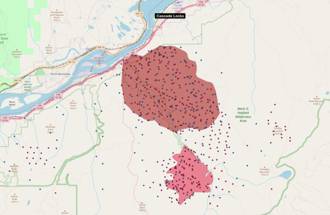 The red and blue dots indicate hot spots detected by satellites. The dark red area is the Eagle Creek fire first reported Saturday. The pink area is the Indian Creek fire that's burned since July 4. Sources: U.S. Geological Survey, U.S. Bureau of Land Management, NASA