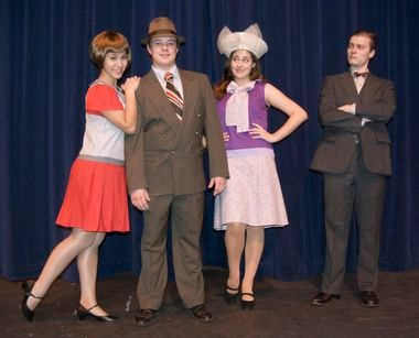 "Olivia Klugman as Millie (from left), Logan Dart as Jimmy, Rachel Hawkins as Miss Dorothy, and Paxton Crystal as Trevor Graden The Third in the Wilsonville High School production of ""Thoroughly Modern Millie."""