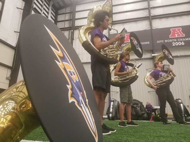 Different sections of the marching band practice before coming together as a group.