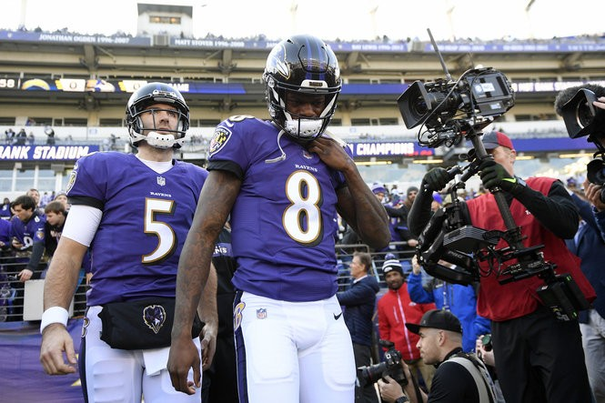 34dfd83a Baltimore Ravens quarterbacks Lamar Jackson (8) and Joe Flacco walk onto  the field before an NFL wild card playoff football game against the Los  Angeles ...