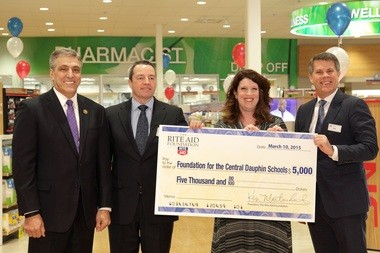 The Rite Aid Foundation presented the Foundation for the Central Dauphin Schools a $5,000 grant. Pictured left to right are Congressman Lou Barletta; Rite Aid chairman and CEO, John Standley; Foundation for the Central Dauphin Schools program coordinator, Amy Snyder and Rite Aid president, COO and president of the Rite Aid Foundation, Ken Martindale.