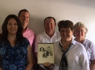 John Heebner (second from the left), principal of Element Risk Management is pictured with members of the Singleton family. Pictured from left to right are Vicky Tarr, Josh Heebner, Glenn Singleton, Anita Sweger and Nancy Singleton. Sweger is holding a picture of is E.M. and Onata Brown, son Louis and Nancy Singleton. E.M. Brown was the original owner of Singleton Insurance Agency.