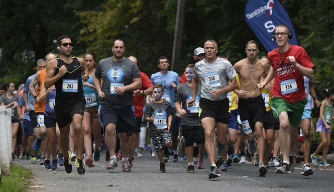 Runners begin the ZERO Prostate Cancer Run/Walk on City Island on Friday night. More than 570 people ran, walked or rode in this year's race and over 900 attended. This has been a capstone event for the Harrisburg area for the past 11 years in recognition of Prostate Cancer Awareness Month.