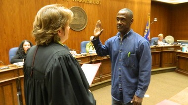 Jeffrey Baltimore takes the oath of office to serve on Harrisburg City Council.