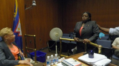 Sandra Reid, right, clutches the nameplate of the late City Council member Eugenia Smith after Kelly Summerford, her nominee to replace Smith, withdrew from consideration.