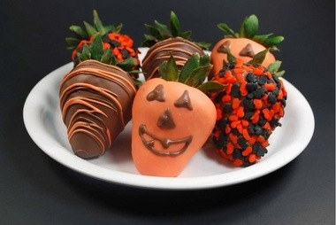 Twigedies Berries specializes in chocolate covered strawberries. Some are decorated to look like Halloween jack o'lanterns, baseballs and footballs. Submitted